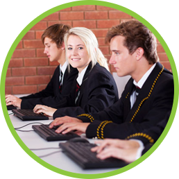 Secondary girl smiles whilst learning on the computer